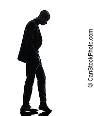 african black man standing looking down silhouette - one...