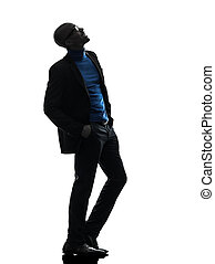 african black man standing looking up smiling silhouette