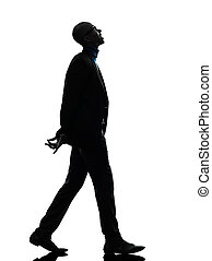 african black man walking looking up smiling silhouette
