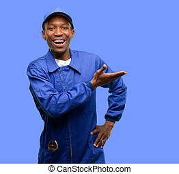 African black plumber man holding something in empty hand