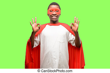 African black super hero man doing ok sign gesture with both hands expressing meditation and relaxation