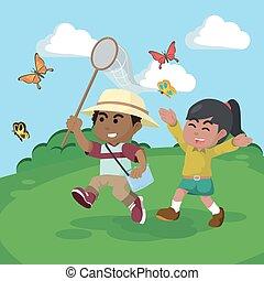 African boy and african girl catching butterflies