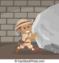 African boy explorer pushing boulder