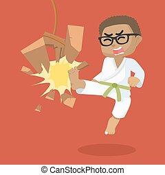african Boy green belt karateka breaking board