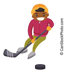African boy playing hockey on outdoor rink.
