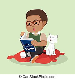 African boy reading while cat watching
