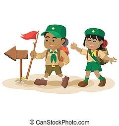 African boy scout following arrow sign