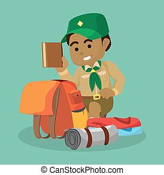 African boy scout packing