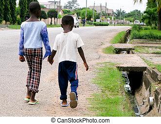 African boys on roadside - Two small boys on the roadside in...