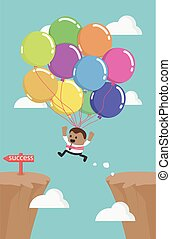 African business man flies across gap to another cliff by using balloon.