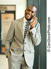 african business man talking on mobile phone