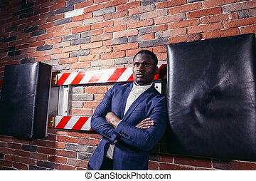 african business man with crossed arms