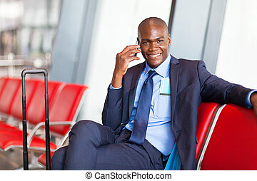african business traveler talking on cell