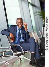 african business traveler talking on mobile