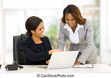 african business women working on a computer