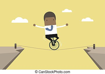 African businessman balancing on the rope.