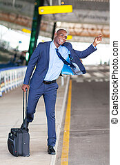 african businessman calling taxi at airport