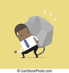 African businessman carrying a big rock.
