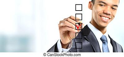 african businessman choosing one of three options
