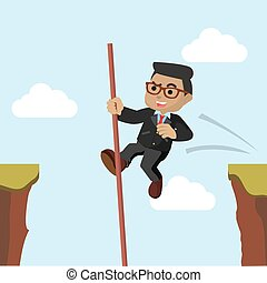 African businessman crossing the cliff with stick