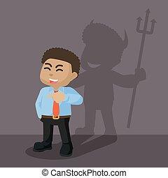 African businessman devil shadow