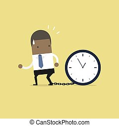 African businessman gets chained with big clock in time concept.