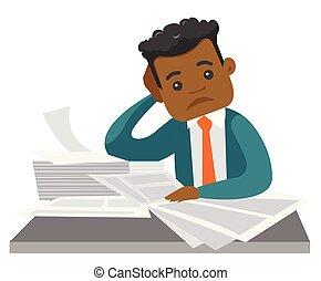 African businessman having a lot of paperwork.