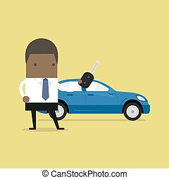 African businessman holding a key of a new car.
