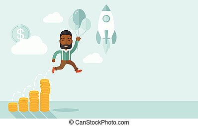 African businessman holding balloons.