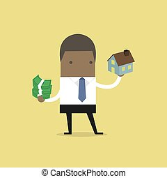 African businessman holding house and money.