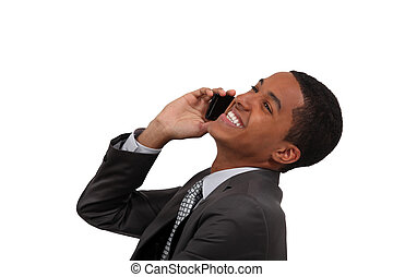 African businessman laughing on the phone