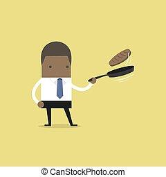 African businessman making fresh pancakes on breakfast.