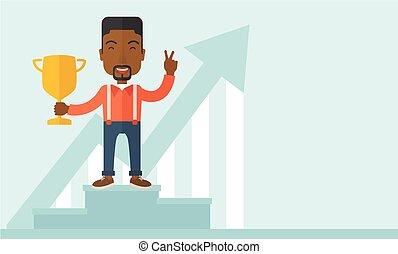 African businessman on winning podium