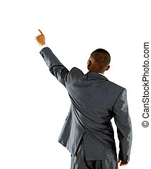 African businessman pointing at wall. rear view. Isolated over white .
