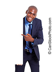 african businessman pointing at white board