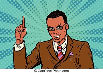 African businessman pointing finger up. Pop art retro vector...