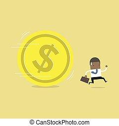 African businessman running away from huge golden dollar coin.