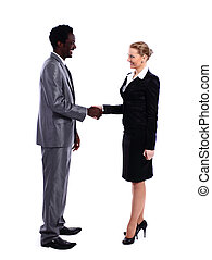 African businessman shaking hands with white business woman