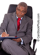 african businessman sitting in office chair isolated on white