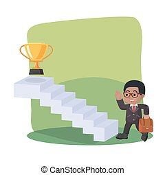 African businessman taking stair to trophy