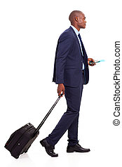 african businessman walking with trolley