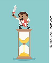 African businessman with an hourglass