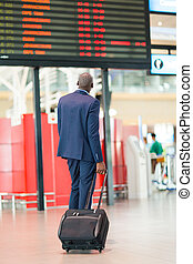 african businessman with luggage
