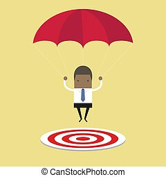 African businessman with parachute focused on a target.
