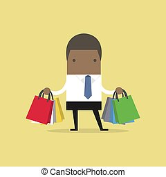 African businessman with shopping bags.