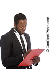 African businessman writing notes on a clipboard