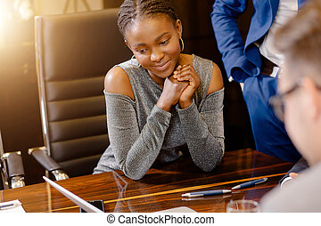 African businesswoman look at camera in boardroom