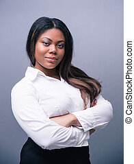 African businesswoman standing with arms folded