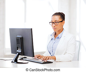 african businesswoman with computer in office