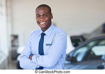 african car salesman portrait